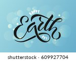 hand sketched text 'happy earth ... | Shutterstock .eps vector #609927704