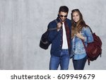 smiling couple in denim and... | Shutterstock . vector #609949679