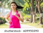 asian sport woman running  ... | Shutterstock . vector #609950390