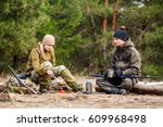 two hunters are eating together ...   Shutterstock . vector #609968498