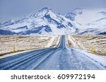blue road in iceland with big... | Shutterstock . vector #609972194