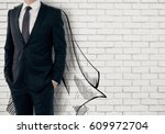 businessman with drawn cape on... | Shutterstock . vector #609972704