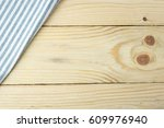 tablecloth on wooden table... | Shutterstock . vector #609976940