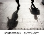 shadow of two person on... | Shutterstock . vector #609982094