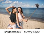 two female friends taking... | Shutterstock . vector #609994220