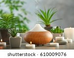 aroma oil diffuser  candles and ... | Shutterstock . vector #610009076