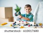 smiling little boy drilling...   Shutterstock . vector #610017680