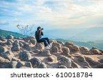 girl taking photo of beautiful... | Shutterstock . vector #610018784