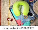 suitcase with different things... | Shutterstock . vector #610032470