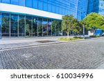 empty pavement and modern... | Shutterstock . vector #610034996
