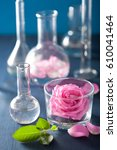 Small photo of alchemy and aromatherapy set with rose flowers and chemical flasks
