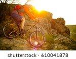 cyclist riding the mountain... | Shutterstock . vector #610041878