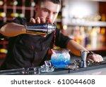 bartender pouring fresh... | Shutterstock . vector #610044608