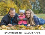 smiling young parents with... | Shutterstock . vector #610057796