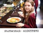 beautiful little girl receiving ... | Shutterstock . vector #610059890