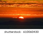 view of sunrise and mountain... | Shutterstock . vector #610060430