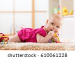 baby girl 7 months chewing on... | Shutterstock . vector #610061228