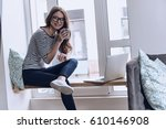 good coffee makes her happy.... | Shutterstock . vector #610146908