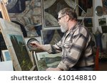 elderly painter with beard and