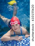 young girl learning to swim in... | Shutterstock . vector #610155620