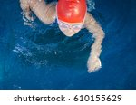 young girl learning to swim in... | Shutterstock . vector #610155629