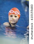 young girl learning to swim in... | Shutterstock . vector #610155683