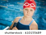 young girl learning to swim in... | Shutterstock . vector #610155689