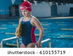 young girl learning to swim in... | Shutterstock . vector #610155719