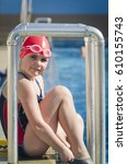 young girl learning to swim in... | Shutterstock . vector #610155743