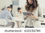 businesswoman using tablet in... | Shutterstock . vector #610156784