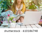 casual business woman using her ...   Shutterstock . vector #610186748