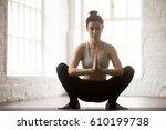 young attractive yogi woman... | Shutterstock . vector #610199738