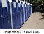 row of portable toilets on city