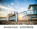 group of friends going to surf... | Shutterstock . vector #610238408