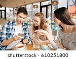 friends using smartphones...   Shutterstock . vector #610251800
