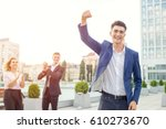 young man raised his arms up as ... | Shutterstock . vector #610273670