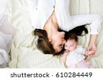 mother with baby | Shutterstock . vector #610284449