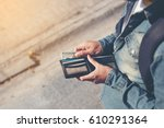 Stock photo hipster man hands holding wallet with credit cards and stack of money 610291364