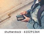 hipster man hands holding... | Shutterstock . vector #610291364