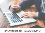 handsome businessman in suit... | Shutterstock . vector #610295240