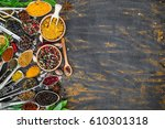 various spices spoons on stone... | Shutterstock . vector #610301318