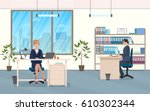 man and woman at the desk in... | Shutterstock .eps vector #610302344