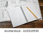 Open Blueprints On Wooden Tabl...