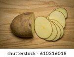 Sliced Raw Potato On Wooden...