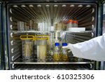 scientists take duran bottle... | Shutterstock . vector #610325306