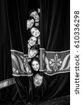 Small photo of Theater actors peek out from behind the curtain. actor, head, curtain