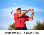 active senior man swinging an... | Shutterstock . vector #610364708