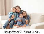 mother with her three children  ... | Shutterstock . vector #610384238