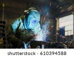 welders working at the factory... | Shutterstock . vector #610394588