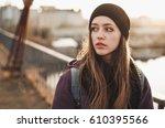 hipster girl walking on the... | Shutterstock . vector #610395566
